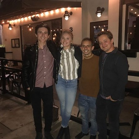 Moises Arias (second right) with his co-stars Emily Osment (second left), Jason Earles (right) and Mitchel Musso (left) in a reunited moment.