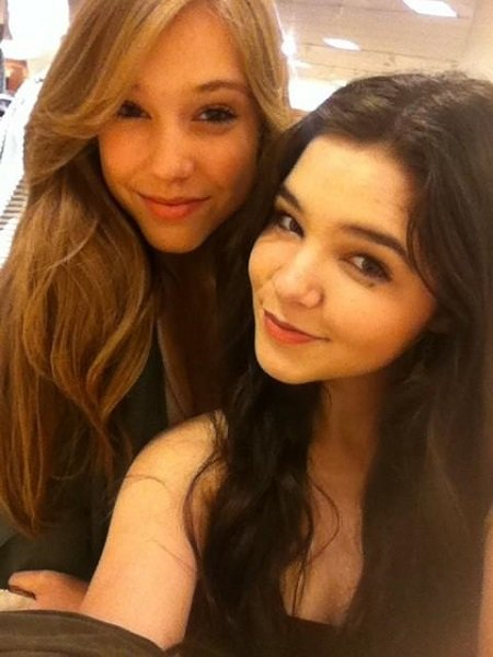 Madison taking a selfie with Model Alexis Ren on her right and a little behind but hugging each other.