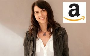 MacKenzie Bezos smiling beautifully with an amazon logo on the top right corner of the photo (only 'a' and the arrow). Jeff Bezos's ex-wife has a net worth of $35 billion after the divorce.