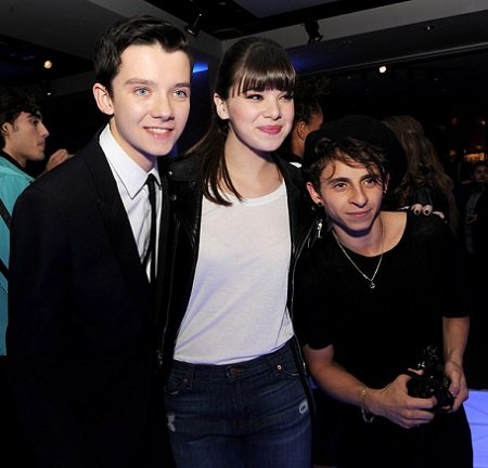 (L-R) Actors Asa Butterfield, Hailee Steinfeld and Moises Arias pose at the after party for the premiere of Summit Entertainment's 'Ender's Game' at The Annix on October 28, 2013 in Los Angeles, California.