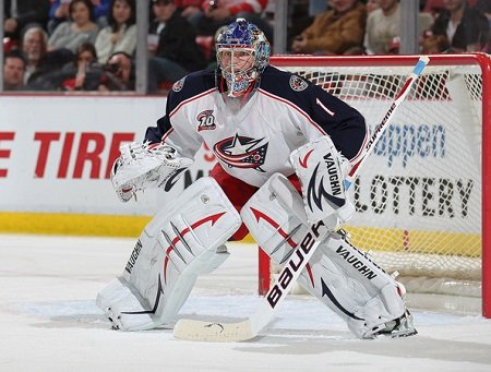 Steve Mason #1 of the Columbus Blue Jackets gets set to face one of the shots in a shut-out against the Detroit Red Wings on February 4, 2011 at the Joe Louis Arena in Detroit, Michigan. The Blue Jackets defeated the Wings 3-0. (Feb. 3, 2011 - Source: Claus Andersen/Getty Images North America)