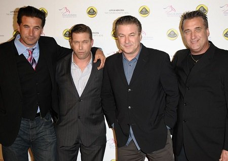(From left) William Baldwin, Stephen Baldwin, Alec Baldwin and Daniel Baldwin all looking at the camera standing arm in arm. Stephen is the youngest.