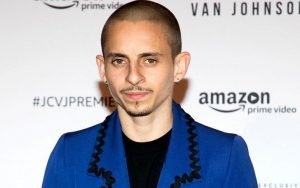 Moises in his bald look wearing a blue coat shirt. His Net Worth is estimated to be around $650,000.