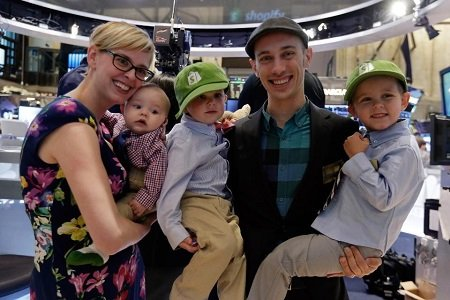 'Shopify Inc.' CEO Tobias Lutke and wife Fiona McKean, pose with their children: Fraser, Sam and Tristan, left to right, on the floor of the New York Stock Exchange, before the company's IPO, Thursday, May 21, 2015.