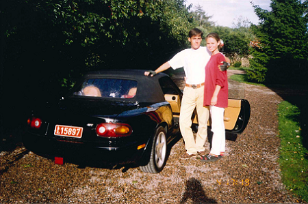 The black Mazda MX from the year 1991 as the two young Koenigseggs are standing beside the car.