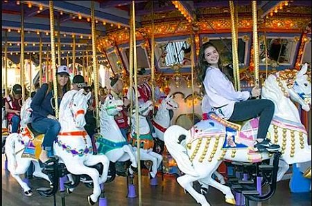 "Nicole Boice (left), Founder and CEO of Global Genes, and Madison McLaughlin, star of ""Arrow"" taking a ride on the King Arthur Carousel during the ""Carousel of Possible Dreams"" fundraiser for the Festival of Children Foundation at Disneyland in 2016. (Photo by Mark Eades, Orange County Register/SCNG)"