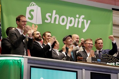 Everyone is clapping for Tobi Lutke (net worth $2.8 Billion) in the stands looking at a screen (not shown in photo) for he is a genius who created shopify.