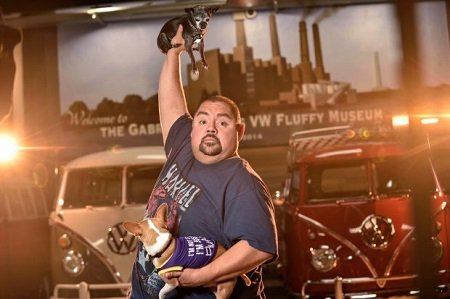 Comedian Gabriel ÒFluffyÓ Iglesias with his Chihuahuas, Risa, left, and Vinnie, at his compound in Signal Hill, California, on Monday, Dec 18, 2017. Iglesias has a classic VW bus collection along with studio and a warehouse for his merchandise at The Fluffy Compound.