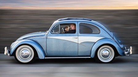 Gabriel Iglesias in his Volkswagen Bug with his dog..