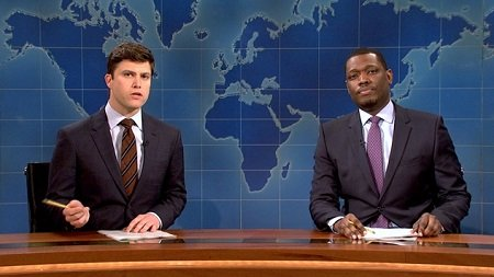 Colin Jost and Michael Che hosting the Weekend Update of SNL. Jost has a net worth of $6 million.