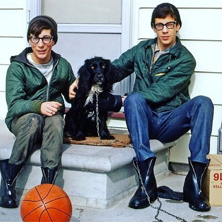 Young Marty and Rick Lagina in front of their doorstep with their dog.