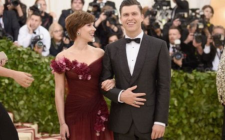 Scarlett Johansson looking soulfully at her fiance, Colin Jost.