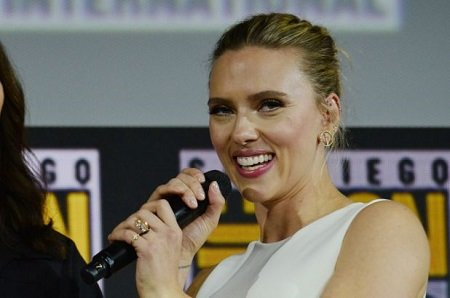 Scarlett Johansson holding a mic at the San Diego Comic-Con 2019.