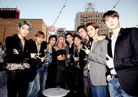 Loren Gray pictured in the center with the K-pop group NCT 127.