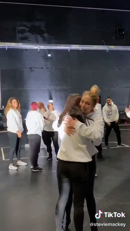 Jennifer Lopez's face is seen as she hugs Charli D'Amelio after the dance ended.