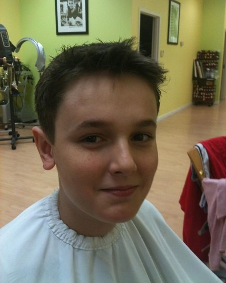 A 10-year-old Bryce Hall during a haircut.