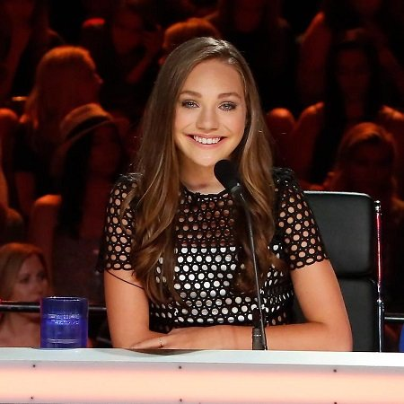 Maddie Ziegler as a Judge on a dance show.
