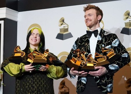 Billie Eilish with brother Finneas O'Connell with five Grammys each.