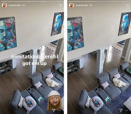 An inside glimpse of Eva Marcille's Living room with her newborn in sight of the paintings mentioned above.