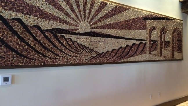 A sunset mural made up of corks as mentioned in the paragraph.