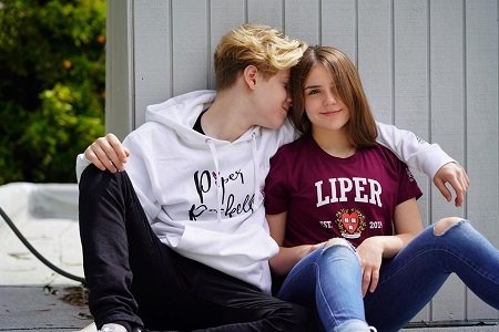 Piper Rockelle wearing a 'Liper' shirt and Lev Cameron wearing a Piper Rockelle hoodie being romantic.