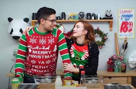 Julie Nolke and Her Boyfriend Sam Larson in a Christmas vibe staring at each other.