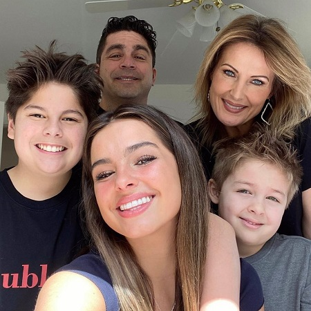 Addison Rae taking a selfie with her entire family.