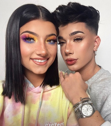 Charli D'Amelio with James Charles with her makeup on.