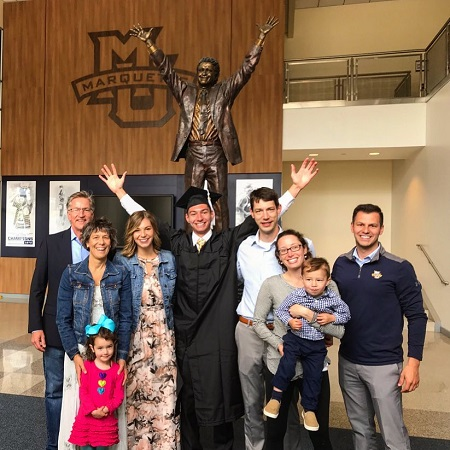 Peter Fornetti with his family, two brothers, one sister, one sister-in-law, a nephew and a niece and his parents,during his graduation from Marquette University.