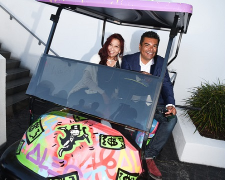 Anna Shay (L) and comedian George Lopez attend the 8th Annual George Lopez Celebrity Golf Classic Pre-Party at the SLS Hotel on May 3, 2015 in Beverly Hills, California.