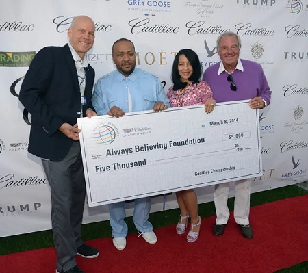 (L-R) David Pillsbury,Timbaland, Monique Mosley and Butch Buchholz attend GREY GOOSE Vodka and the Cadillac Championship Toast Travie McCoy at the Trump National Doral on March 8, 2014 in Doral, Florida.