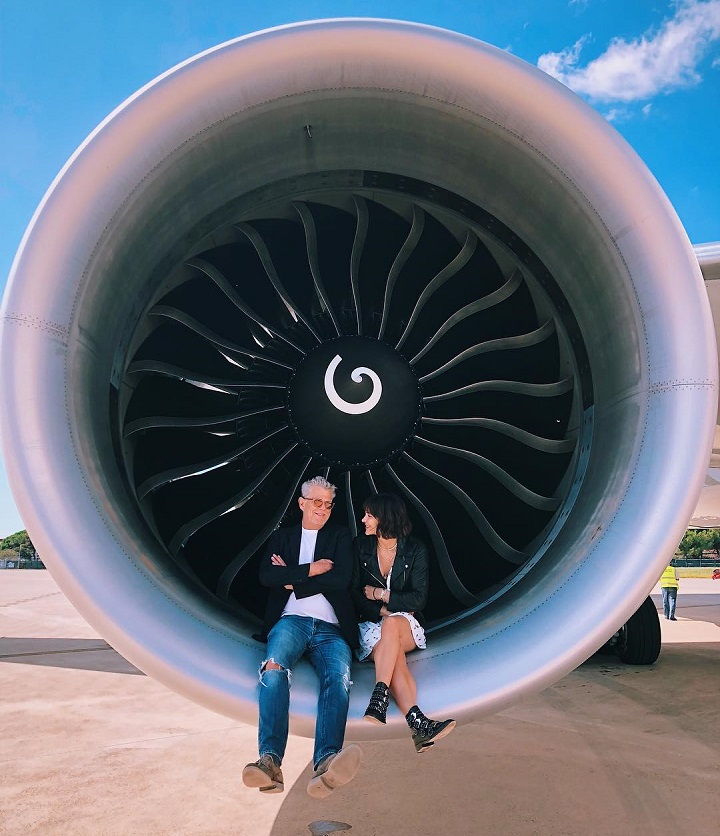 Katharine McPhee and David Foster sitting in the turbine engine head of their private jet.