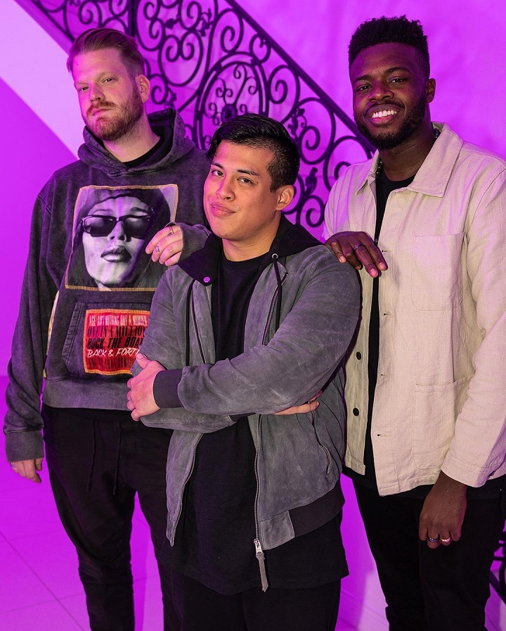 Spencer X in the middle posing with Jason Derulo and Scott Hoying in his house.