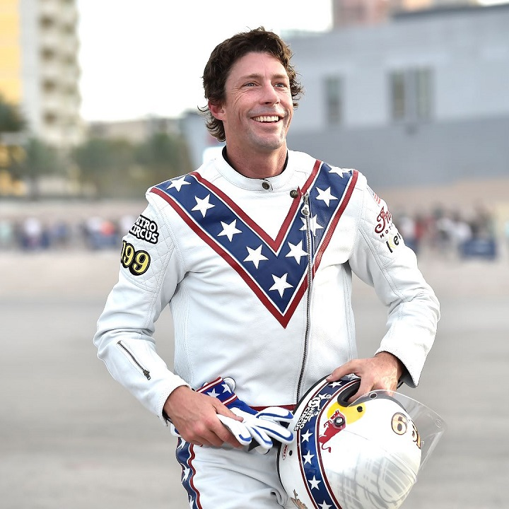 Travis Pastrana in his Evel Knievel costume after complete three of his greatest jumps on a motorbike.