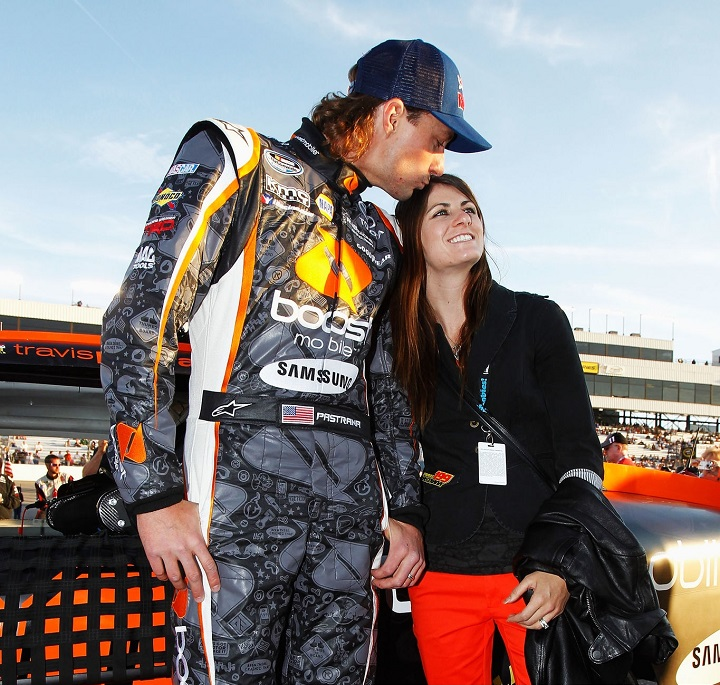 RICHMOND, VA - APRIL 27: Travis Pastrana (L), driver of the #99 Boost Mobile Toyota, and his wife Lyn-Z stand on the grid before the NASCAR Nationwide Series Virginia 529 College Savings 250 at Richmond International Raceway on April 27, 2012 in Richmond, Virginia.