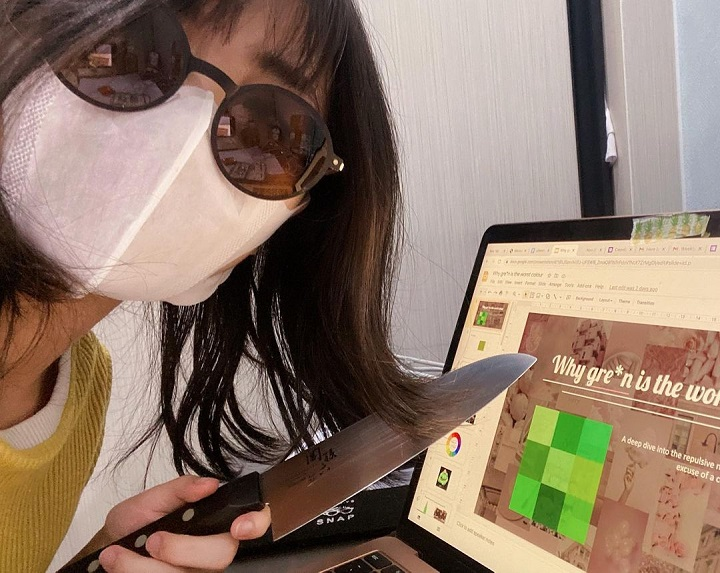 """Faline San during the making of her presentation for her video on why green is the """"worst"""" color."""