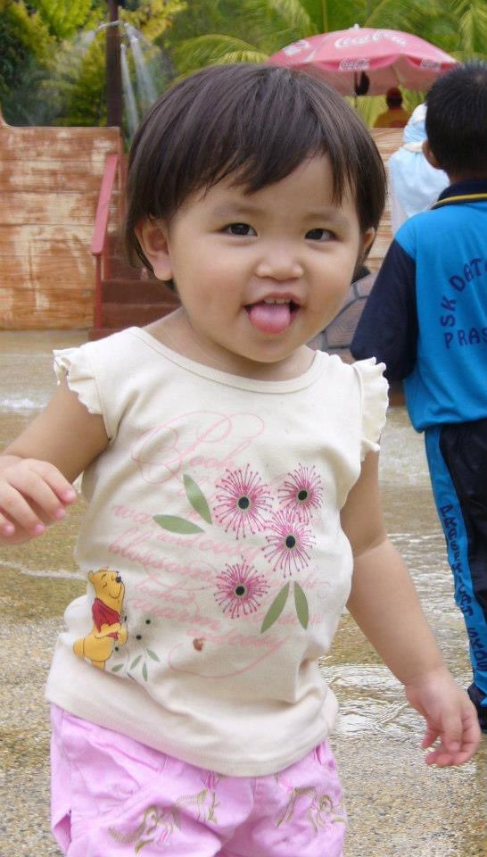 Faline San as a child sticking her tongue out.