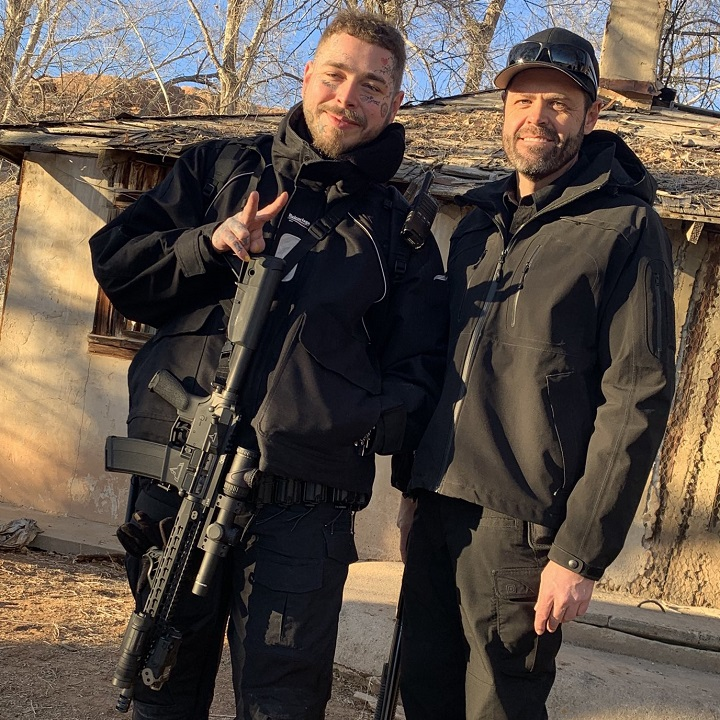 Bryant Arnold (right) with Post Malone (left) during the singer's visit to the Skinwalker Ranch.