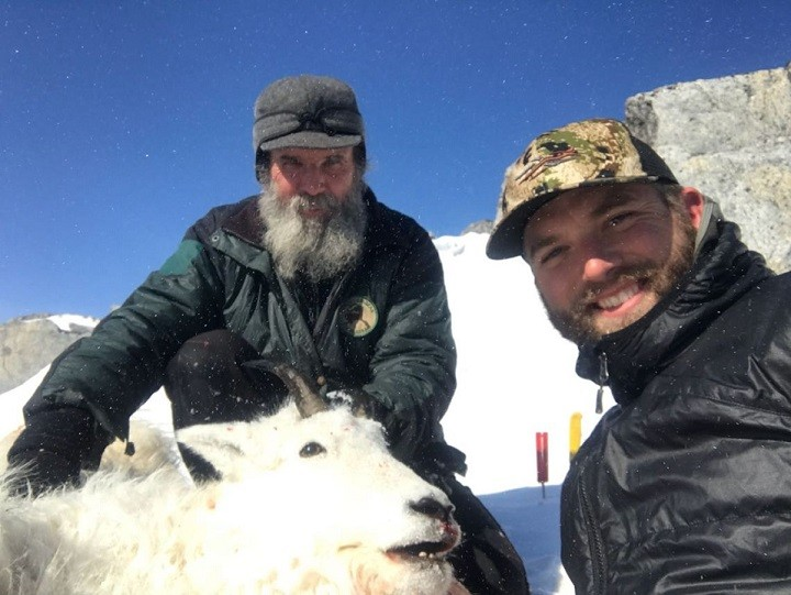Mike Horstman (left) with a client (right) during one of their mountain goat hunts.